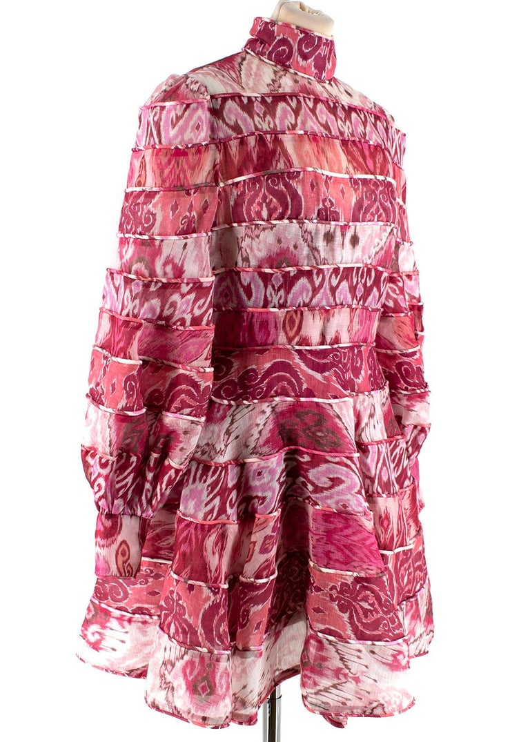 Zimmermann Women's Pink Ikat Print Mini Dress  - Fit and Flare - Back Zip Fastening - Stitched Panels  - Feminine Bishop Sleeves with Fitted Cuffs  -  High Standing Collar  - Slip Dress Insert with Adjustable Straps   Material: - 51% Linen  - 49%