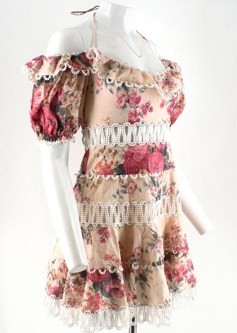 Zimmermann Melody Meadow Floral-Print Tiered-Frill Mini Dress  - All-over Meadow Floral print. - Delicate broderie anglaise throughout.  - Boning around the bust for structure and support.  - Concealed zip fastening at the back. - Off-the-shoulder