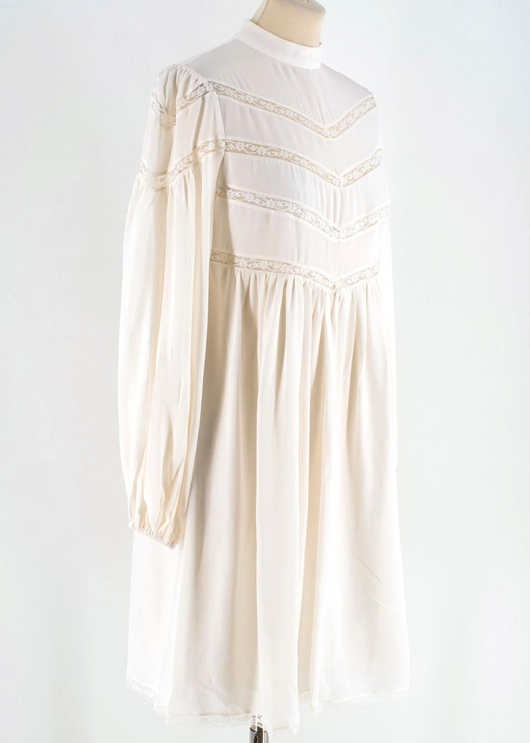 Zimmermann silk white high neck mini dress  -White silk dress -Long sleeve with banding finishing -Lace trim finishing -Back Zip(Good in condition) -High neck  Please note, these items are pre-owned and may show signs of being stored even when