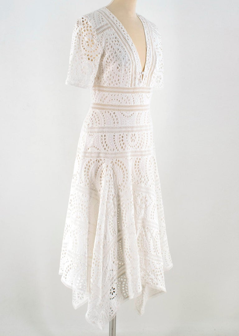 Zimmermann White Broderie Asymmetric Midi Dress  - Embroidered white Floral cotton - Rather short cut - Deep V neckline dress - Fluted ruffles throughout sleeves and hem - Loop insert trim throughout sleeves and skirt - Invisible side zip closure -