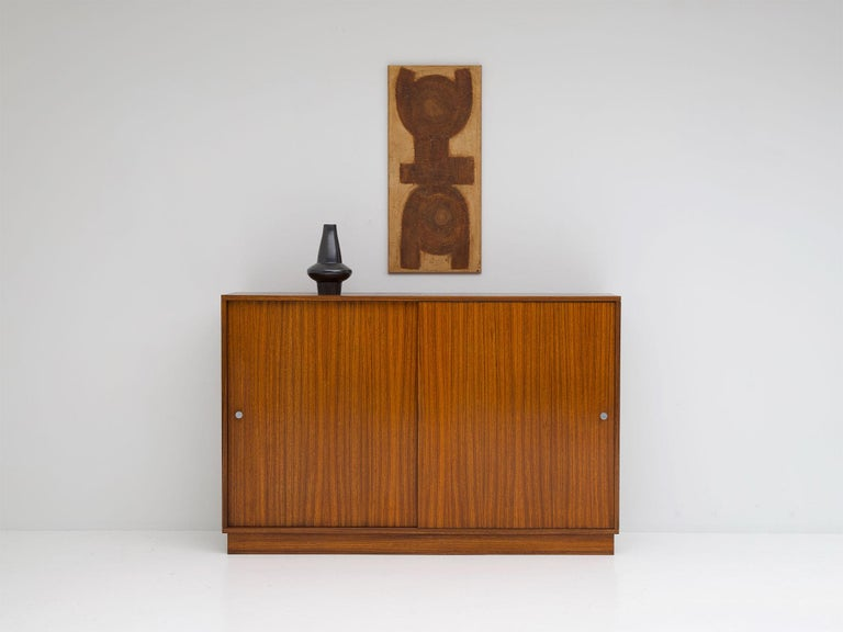 Alfred Hendrickx, Belgian modern, zingana wood, sliding doors, Belform Belgium 1960s  This cabinet was designed by Alfred Hendrickx for Belform in the mid-1960s. It has two sliding doors and offers a lot of storage space due the shelves inside.