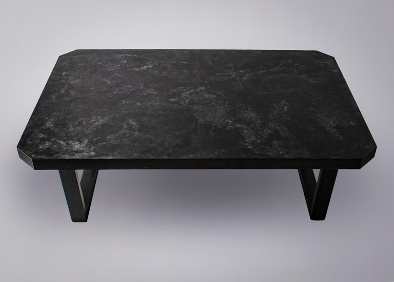 Custom distressed dark zink octogon shaped dining table with black hollow steel base.