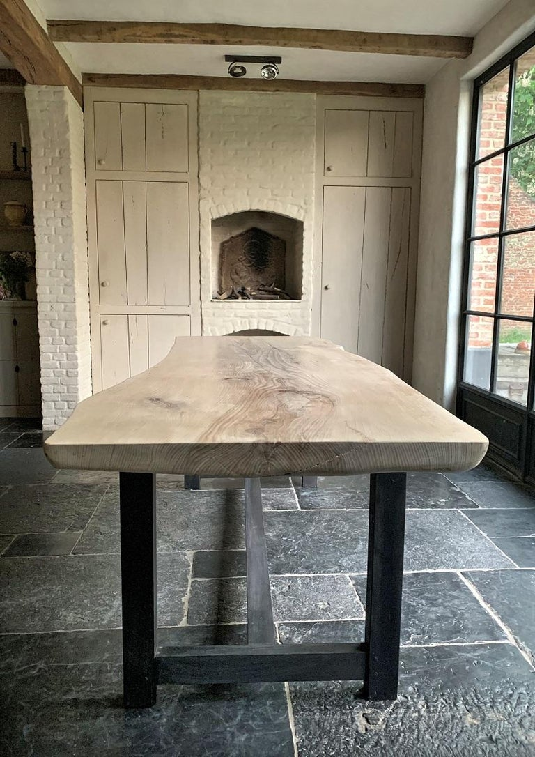 We designed and made this table starting from a locally harvest beech tree. As it had to make way from a construction site we purchased some beautiful tree's. After drying we started to process the wood and let it tell us what to use for what