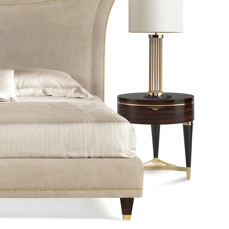 This superb nightstand is a striking piece of functional decor that will make a statement in any bedroom. Its round top and sides are made in ziricote wood, whose unique and large grain adds a one-of-a-kind decoration to the surface of the piece.