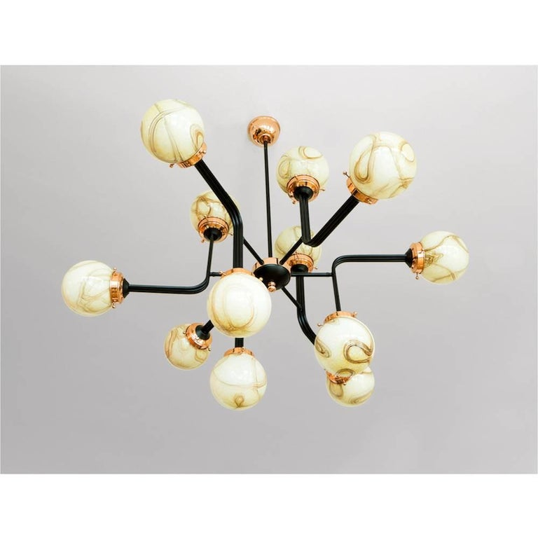 From esteemed Turkish designer, Merve Kahraman comes the handmade Ziron chandelier light fixture.