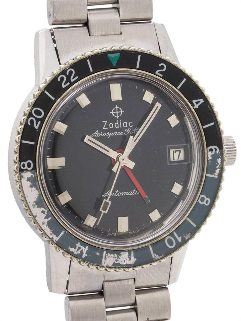 Zodiac Stainless Steel Aerospace GMT automatic circa 1960's. 36mm case with screw down case back, rotating 24 hour black and blue/gray acrylic bezel with green triangle 24 hour index, and a loss of color from 16-18. Glossy black original dial with