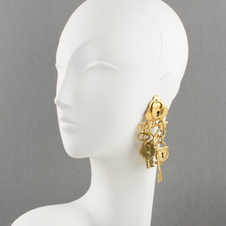 Spectacular Zoe Coste France gilt metal dangling clip-on earrings. Oversized shape featuring old keys and locks in a total dramatic flair. Very interesting design by famous French jewelry designer Zoe Coste, creator of Reminiscence brand. Brand