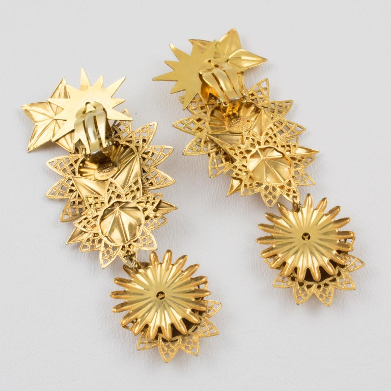 Zoe Coste Gilt Metal Dangle Clip Earrings Star and Sun For Sale 1