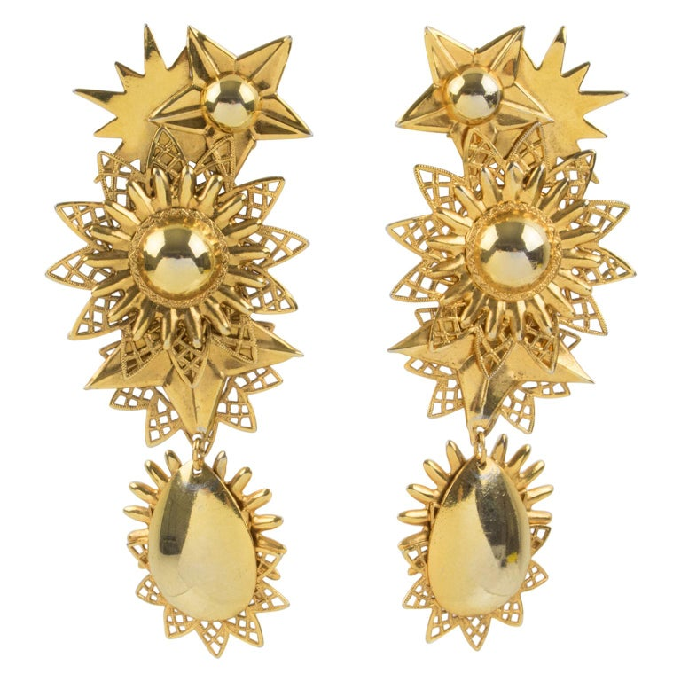 Zoe Coste Gilt Metal Dangle Clip Earrings Star and Sun For Sale