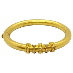 Zolotas 22 Karat Yellow Gold and .26 Carat Diamond Hammered Bangle Bracelet