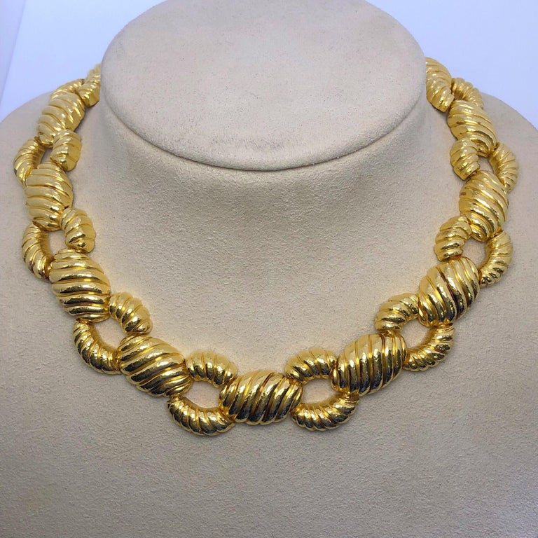 This beautiful necklace is designed by Zolotas of Athens, Greece. Founded in 1895 the company merges Greek heritage with modern style to create these timeless pieces which have since been Coveted by both Royals and Actresses. Composed of 22 karat