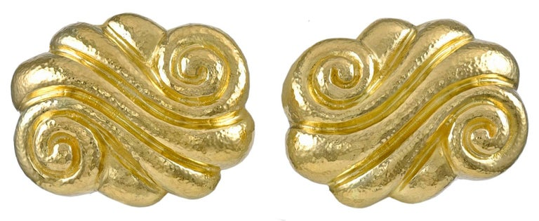 Most attractive sculptural earrings.  Made and signed by ZOLOTAS.  22K textured gold.  Beautiful organic shape, with a rich patina.  1