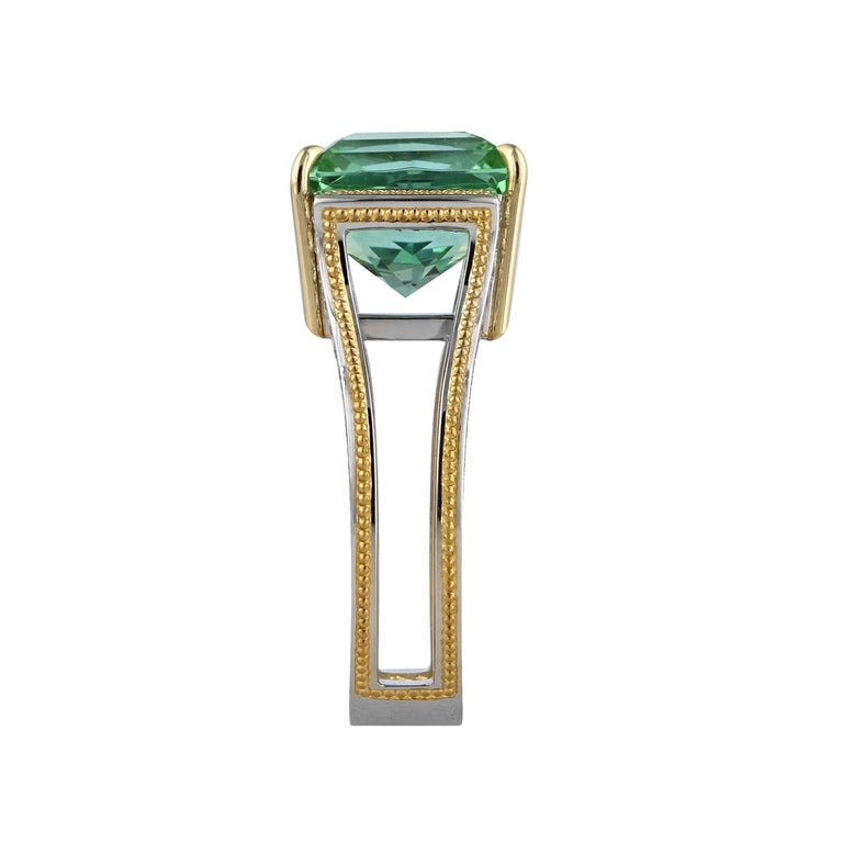 Spectacular 5.80 ct. teal colored Tourmaline set in Platinum and accented with seventy-two round brilliant diamonds with a total weight of .58 ct. of DEF color/ Internally Flawless to VVS clarity Ideal cut Diamonds. 18K Gold prongs and 24K Gold