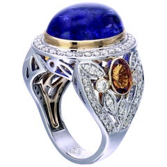 Zorab Creation, Bluebird 15 Carat Tanzanite, Diamond and Spessartite Garnet Ring