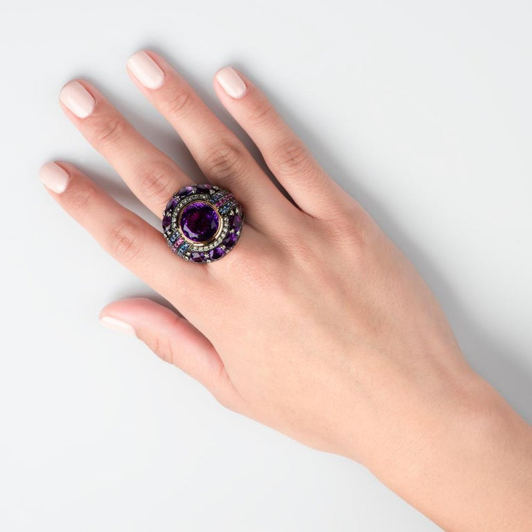 Opulence equals art deco and the opulent color of the era: majestic purple. 1920's flappers fled platinum's weight and white gold was introduced to the world.  Bold lines interfaced with circular motifs and the super-rich sought symmetry. Welcome to