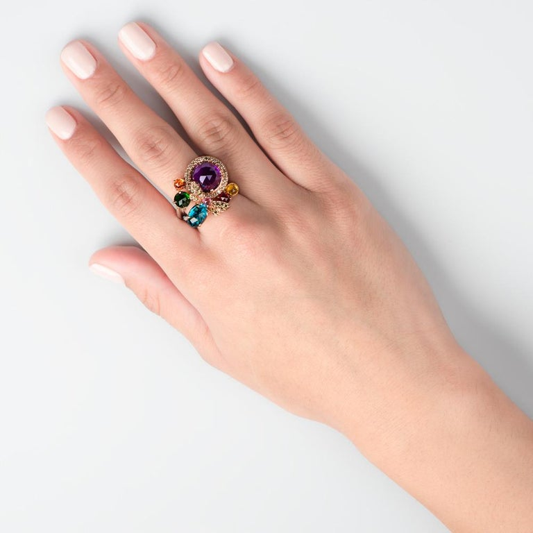 A splendid spectrum of color awaits your hand with the Precious Kaleidoscope ring, a Zorab Creation.  Mesmerizing in its brilliantly light catching tones, yellow diamonds 0.26 carats meet yellow sapphires 0.37 carats and glowing amethysts 4.30