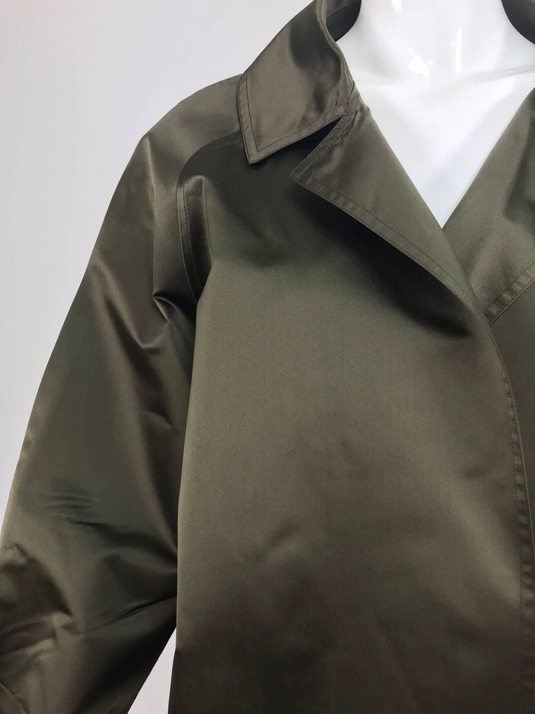 Zoran Dark Olive Silk Jacket...Dark olive silk satin jacket is open at the front with notched lapels, long raglan sleeves are full and straight to cuffs...The jacket is unlined with finished seams throughout...Classic Zoran chic and stylish...Fits a