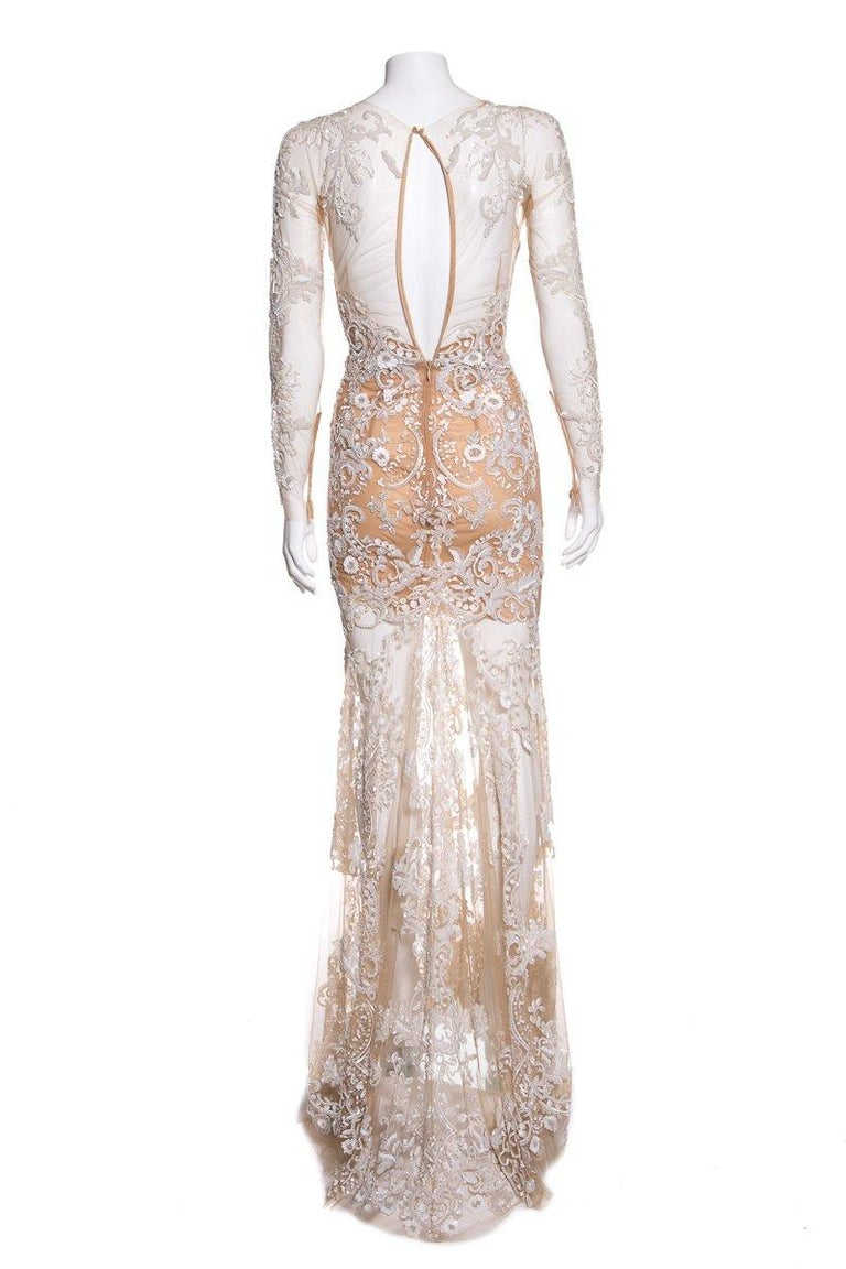 Zuhair Murad long sleeve, mesh gown with sequin and beaded embellishment throughout and concealed back zip closure. This item is previously worn with no major signs of wear. Fabric: Silk/Polyamide   Size 4   Bust: 30