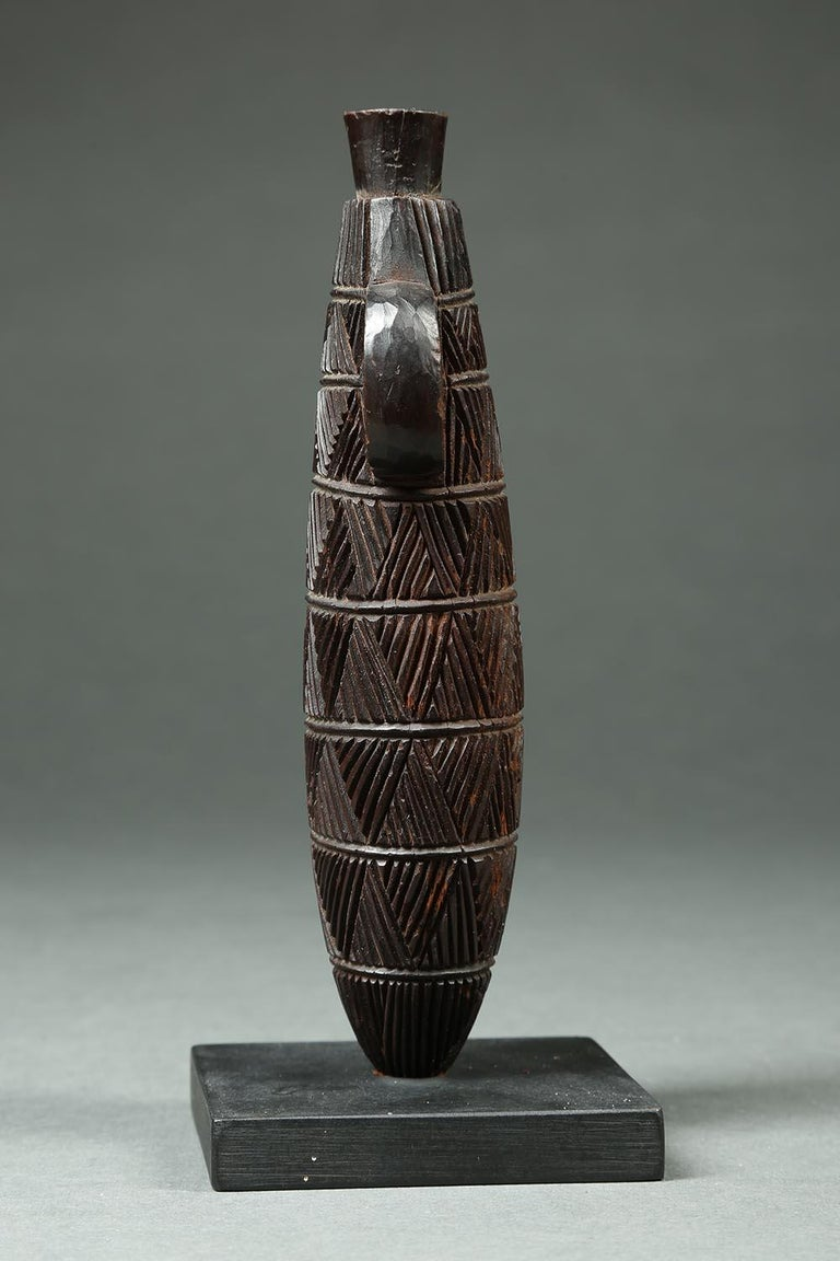 Zulu Tribal carved wood Snuff Container, South Africa  A finely carved snuff container with great geometric designs, a great example of the detailed work the Zulu are known for. Early 20th century, 7 inches high, in very good condition.