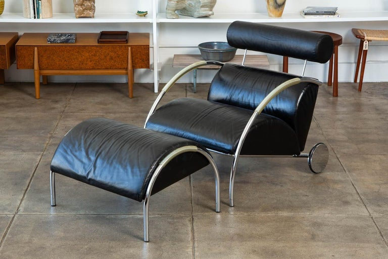 "The postmodern ""Zyklus"" chair and ottoman were designed by Peter Maly for COR in Germany. The Art Deco-inspired chair and ottoman were designed in 1983 and won a German furniture design award in 1984. The piece features a frame upholstered in the"