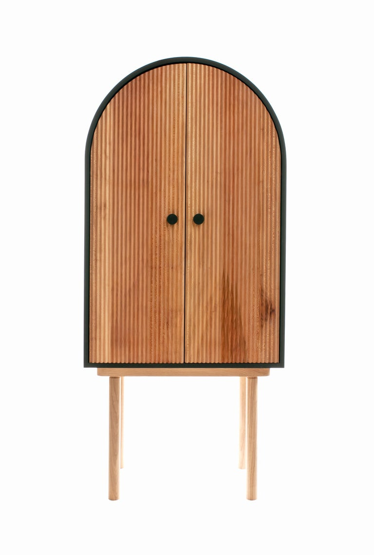 The ZZ Cabinet is a contemporary interpretation of a bar cabinet or dry bar. Inspired by classic architecture forms and textures, the ZZ Cabinet balances simplicity and visually striking textures. The surface of the doors accentuates the unique